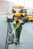 Worker at asphalting works Stock Image