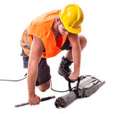 Worker assembling a Jackhammer Royalty Free Stock Photo