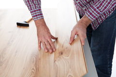 Worker assembling laminate floor Royalty Free Stock Photos