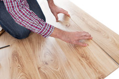 Worker assembling laminate floor Royalty Free Stock Photography