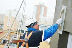 Free Worker At Plastering Facade Work Royalty Free Stock Images - 51983439