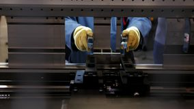 Worker at automate machine on Industrial factory. Close up stock video