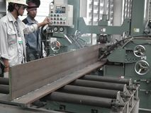 Worker with automatic welding steel beam iron carrier inert gas royalty free stock photo