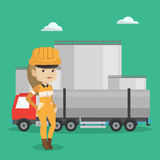 Worker on background of fuel truck and oil plant. Stock Image