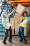 Worker balancing heavy cardboard boxes Royalty Free Stock Image
