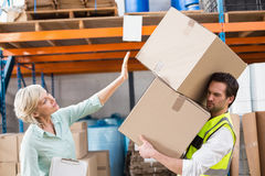 Worker balancing heavy cardboard boxes Royalty Free Stock Photography
