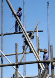 Worker on a bamboo scaffolding Stock Photography
