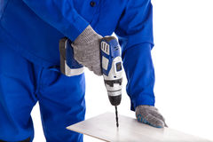 Worker with battery screwdriver Stock Photo