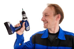 Worker with battery screwdriver in his hand Royalty Free Stock Images