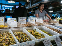 Worker behind pasta display, Pike Place Public Market, Seattle Royalty Free Stock Image