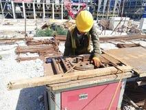 Worker bending rebars royalty free stock photo
