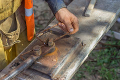 Worker bending spacers for the rebars in a concrete post Royalty Free Stock Image