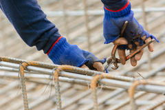 Worker bending steel for construction Stock Image