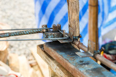 Worker bending steel for construction job Royalty Free Stock Image