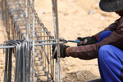 Worker bending steel rod for construction job Stock Photography