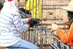 Worker bending steel rod for construction job Stock Photos