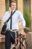 Worker with bicycle. Young handsome office worker going to work on his bicycle. Healthy lifestyle concept Stock Photography