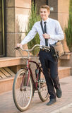 Worker with bicycle Royalty Free Stock Images