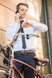 Worker with bicycle. Young handsome office worker going to work on his bicycle. Healthy lifestyle concept Stock Photo