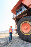 Worker Big Truck in Pit Royalty Free Stock Photography