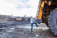 Worker BigTruck in Open Pit Royalty Free Stock Images