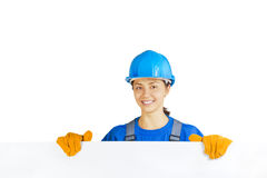 Worker with blank board Stock Photo