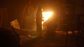 Metallurgist at work by the blast furnance, iron and steel works