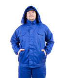 Worker in blue coat and hat. Royalty Free Stock Photography