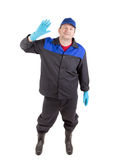 Worker in blue coat and hat. Stock Photography