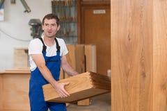 Worker in a carpenter`s workshop Stock Photos