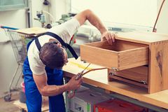 Worker in a carpenter`s workshop Royalty Free Stock Photos