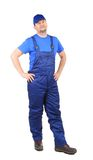 Worker in blue overalls. Royalty Free Stock Photo