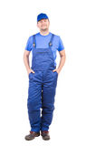 Worker in blue overalls. Stock Photography