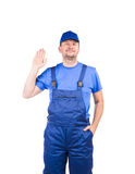 Worker in blue overalls. Stock Images
