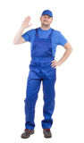 Worker in blue overalls. Stock Photo