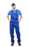 Worker in blue overalls Stock Photo