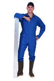 Worker in blue overalls Stock Photos