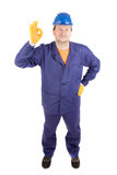 Worker in blue protective helmet. Royalty Free Stock Photo