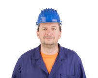 Worker in blue protective helmet. Stock Photo