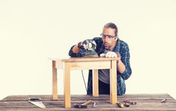Worker in blue shirt repair a table stock photography