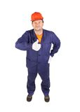 Worker in blue uniform showing thumbs up. Isolated on a white background Stock Image