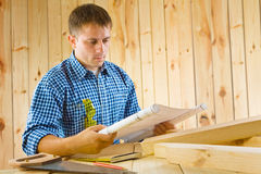 Worker with blueprint Royalty Free Stock Image