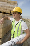 Worker With Blueprint At Construction Site Royalty Free Stock Images