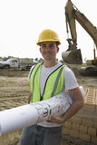 Worker With Blueprint At Site Stock Image