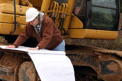 worker with blueprints Stock Photo