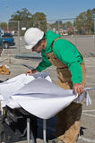 Worker and Blueprints Royalty Free Stock Photography