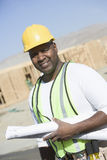 Worker With Blueprints At Site Royalty Free Stock Image