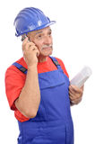 Worker with blueprints talking phone Stock Photography