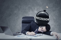 Worker with a bomb of financial recession Royalty Free Stock Photo