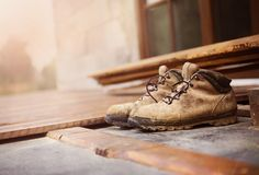 Worker boots on unfinished flooring Royalty Free Stock Image